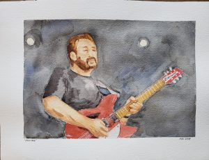 watercolor painting of man playing guitar