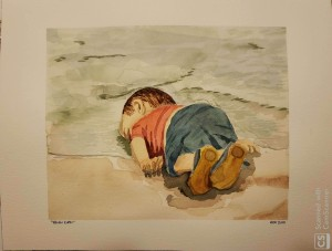 toddler lying facedown in the surf
